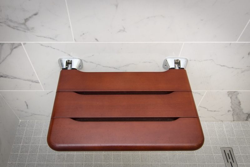 Fold out seat in shower