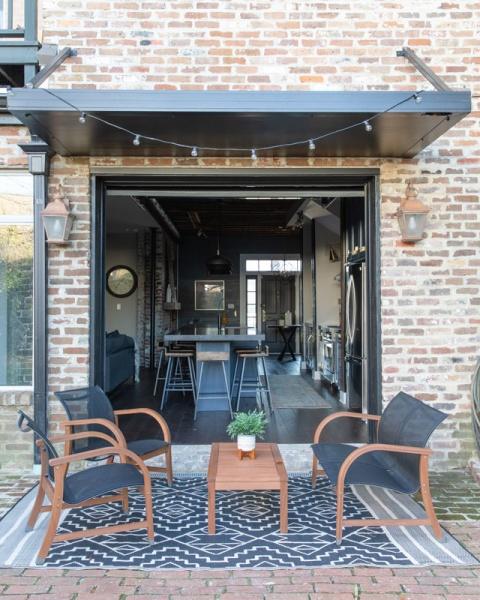 Garage Doors Open to patio.